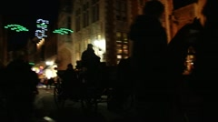 Horse-drawn carriage in Bruges' streets at night5 Stock Footage