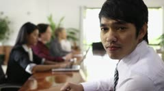 Young Asian manager at work in meeting room during conference Stock Footage