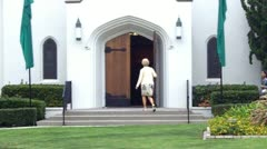 Older Woman Young Woman Enter Church - stock footage