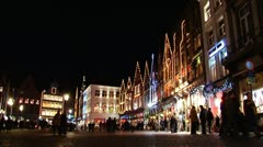 Horse-drawn carriage in Bruges' streets at night. 3 views Stock Footage