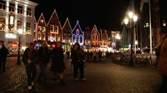 Bruges—Pedestrian on Market square at night2 Stock Footage