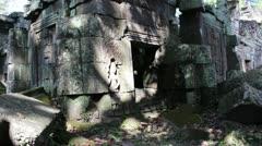 Ancient Temple (Angkor) - Slow pan across broken courtyard Stock Footage