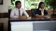 Young business people talking during job interview Stock Footage
