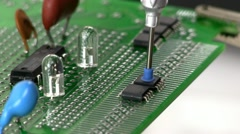 Stock Video Footage of Assemble circuit with surface mount IC by hand