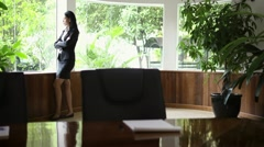 Businesswoman contemplating out of window in conference room - stock footage