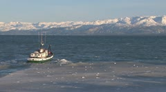 Wooden Boat Heading Out into Icy Kachemak Bay 1 Stock Footage