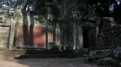 Ancient Temple (Angkor) - Pan Across Giant Tree and Temple_2 Stock Footage