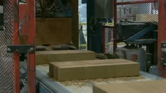 Stone construction blocks moving down assembly conveyor line Stock Footage