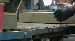 Stone building blocks on conveyor in manufacturing facility Stock Footage