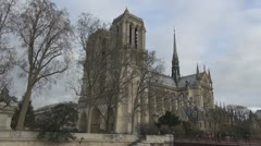 Beautiful Notre Dame Cathedral in Paris france cloudy day church facade cite  - stock footage