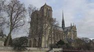 Stock Video Footage of Beautiful Notre Dame Cathedral in Paris france cloudy day church facade cite