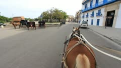 Riding on a horse drawn wagon in Cuba (HD) k - stock footage