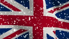 UK snow fallin flag for weather report footage - stock footage