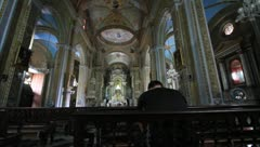 Praying in Cuban cathedral Stock Footage