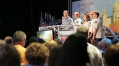 Stock Video Footage of Stock Footage - Rick Santorum and family on stage at Iowa Straw Poll