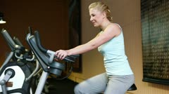 Woman on hometrainer in gym Stock Footage