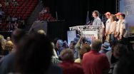 Stock Video Footage of Stock Footage - Rick Santorum on stage with family - Iowa Straw Poll 2011