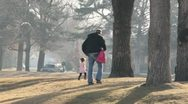 Dad and his daughter play together at the park 1 Stock Footage
