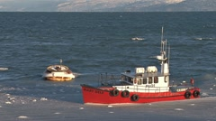 Red Pilot Boat Returning to Icy Harbor 1 Stock Footage