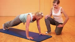 Fitness trainer giving instructions for pushups Stock Footage