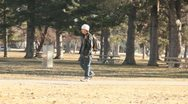 Man all alone walking in the park Stock Footage