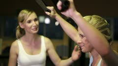 Fitness trainer helping woman on lat machine Stock Footage