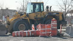 Bull dozer and orange traffic cones Stock Footage