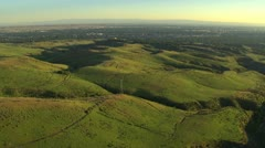 Aerial footage of foothills with Boise, Idaho in distance Stock Footage