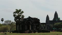 Ancient Temple (Angkor) - Pan to Angkor Wat sillouette WS - stock footage