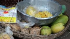 Ancient Temple (Angkor) - Old mango seller and basket at Angkor Wat Stock Footage