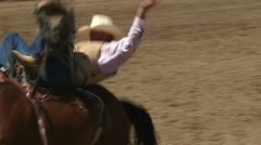 Cowboy Riding Bucking Bronco 3 Stock Footage