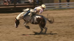 Cowboy Riding Bucking Bronco Slow Motion Stock Footage