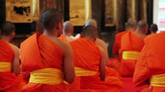 buddhist monks pray in temple - stock footage