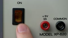 Power button turn on/off; Power Supply Stock Footage