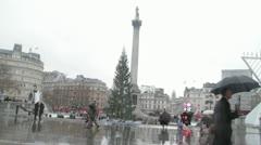 Trafalgar square, London in rain. passers by Stock Footage