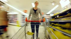 Time Lapse of Lady pushing trolley in Supermarket Stock Footage