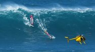 Maui, hi - march 13: professional windsurfer rides a giant wave at jaws. marc Stock Footage