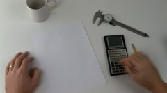 Stock Video Footage of Calculating figures stamped confidential; 2