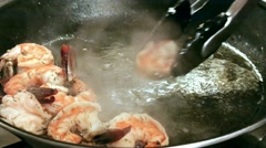Large Fried Shrimps Taken From Pan - stock footage