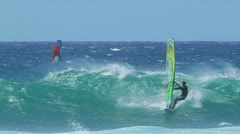 Maui, hi - march 13: professional windsurfer rides a large wave. march 13, 20 Stock Footage