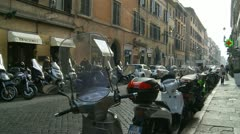 Shopper passes scooters in Rome Stock Footage