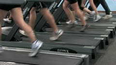 People exercising on treadmills. Feet and legs only Stock Footage