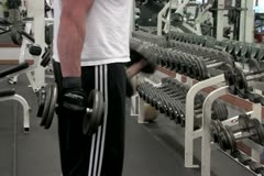 Man lifting free weights with arms Stock Footage