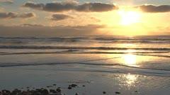Golden Alaskan Beach Sunset over Steaming Surf Stock Footage