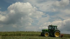Farm tractor working in a field - stock footage