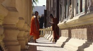 Two monks meet and salute in a buddhist monastery, Cambodia. With Model Release Stock Footage