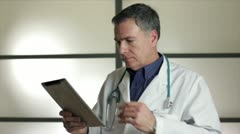 Doctor with tablet bad news Stock Footage