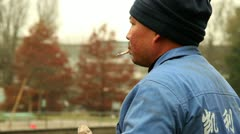 Chinese Worker Smoking A Cigarette - stock footage