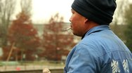 Stock Video Footage of Chinese Worker Smoking A Cigarette