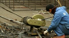 Chinese Craftsman Grinding Steel Pipes Stock Footage